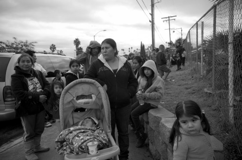 Families of farm workers wait in line to receive presents for their children at First Christian Church in Vista, CA as part of a Christmas giveaway organized by the Indigenous Front of Binational Organizations (FIOB).