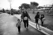 Children of farm workers head home after getting a present in an Christmas toy giveaway event organized by members of FIOB in Vista, CA.