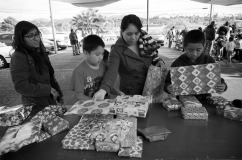 A farm worker's family chooses presents at First Christian Church in Vista, CA as part of a toy giveaway organized by the Indigenous Front of Binational Organizations (FIOB).
