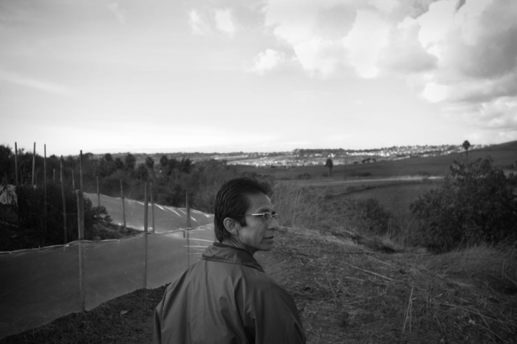 Juan Ramón Reyes walks through one of the canyons where immigrant farmworkers live in shanty home in near Vista, CA. He lived in one of the canyon for four years when he arrive in the US at the age of 14.  /LEOPOLDO PEÑA